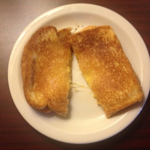 Grilled_cheese_sandwich_on_white_plate